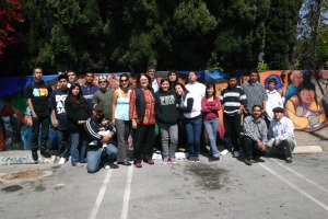 Arts for Action staff, volunteers and youth members visit with renowned muralist Judy Baca